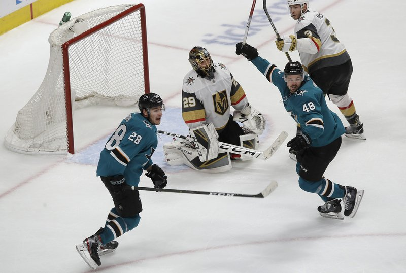 Vegas Golden Knights goaltender Marc-Andre Fleury, center, reacts between San Jose Sharks right wing Timo Meier (28) and center Tomas Hertl (48) after Sharks' Logan Couture scored a goal during the third period of Game 7 of an NHL hockey first-round playoff series in San Jose, Calif. (AP Photo/Jeff Chiu)