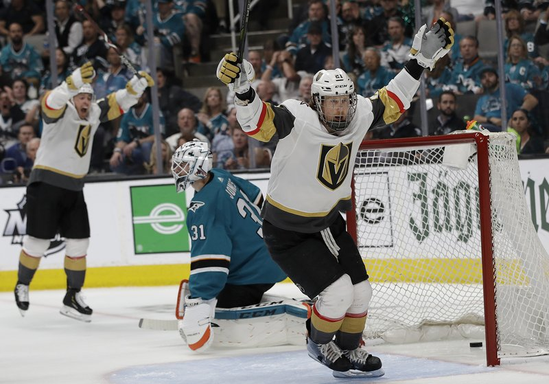 Vegas Golden Knights center Cody Eakin, foreground, celebrates after scoring a goal in front of San Jose Sharks goaltender Martin Jones, center, during the second period of Game 7 of an NHL hockey first-round playoff series in San Jose, Calif. (AP Photo/Jeff Chiu)