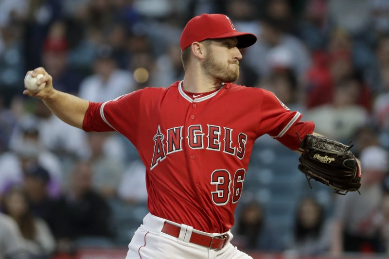 Los Angeles Angels starting pitcher Chris Stratton throws against the New York Yankees during the first inning of a baseball game in Anaheim, Calif. (AP Photo/Chris Carlson)