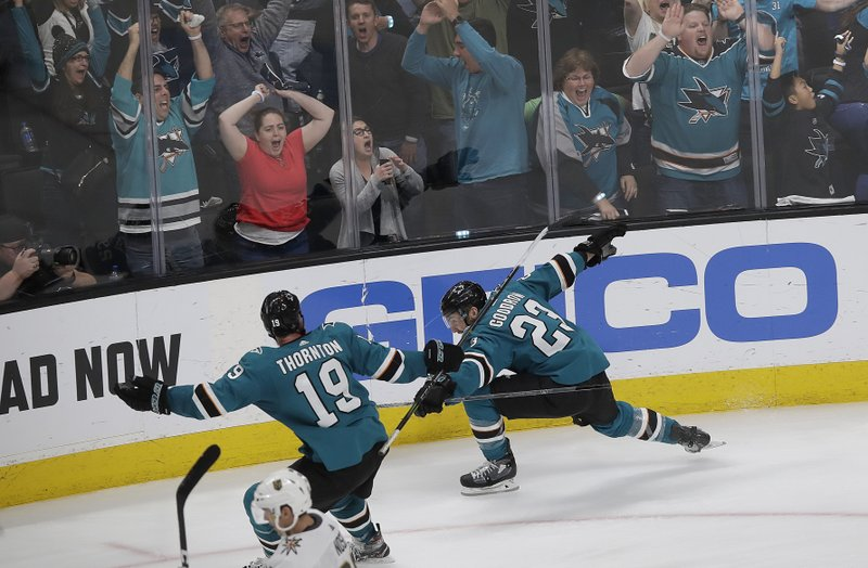 San Jose Sharks right wing Barclay Goodrow (23) celebrates with center Joe Thornton (19) after scoring the winning goal against the Vegas Golden Knights during overtime of Game 7 of an NHL hockey first-round playoff series in San Jose, Calif. (AP Photo/Jeff Chiu)