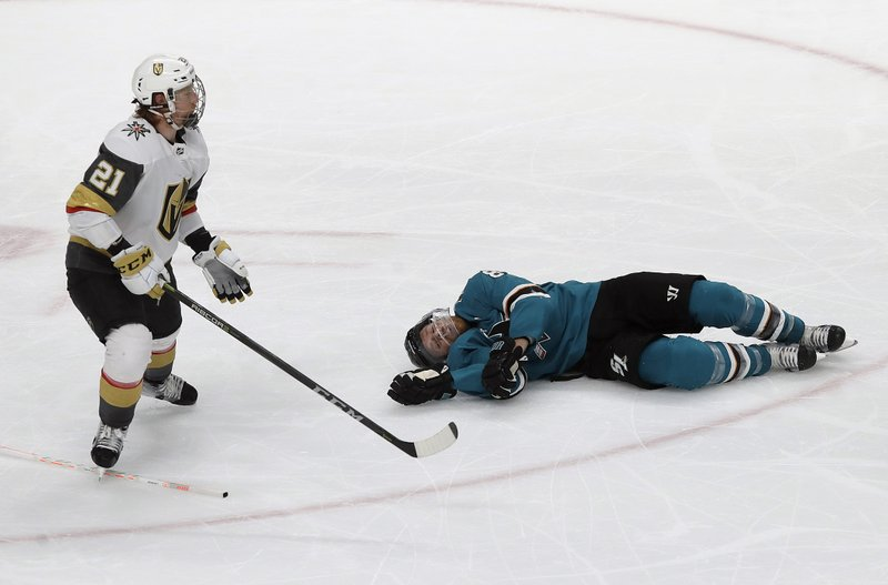 San Jose Sharks center Joe Pavelski, right, lies on the ice next to Vegas Golden Knights center Cody Eakin during the third period of Game 7 of an NHL hockey first-round playoff series in San Jose, Calif. (AP Photo/Jeff Chiu)