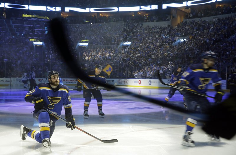 St. Louis Blues' Ryan O'Reilly, left, pauses as teammates skate around him during introductions before Game 3 of an NHL first-round hockey playoff series against the Winnipeg Jets, Sunday, April 14, 2019, in St. (AP Photo/Jeff Roberson)