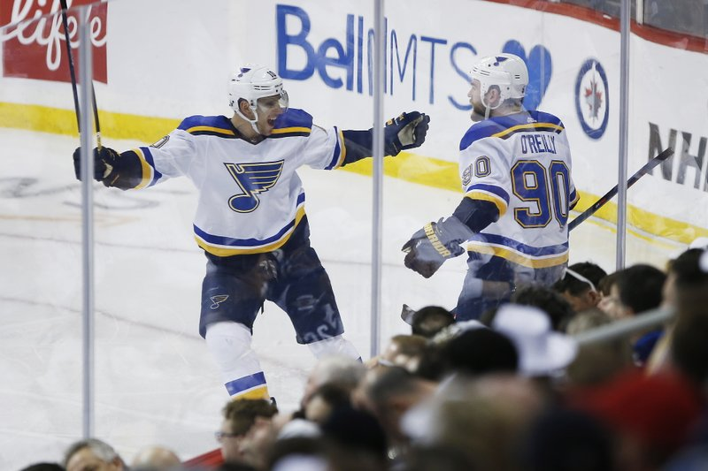 St. Louis Blues centre Ryan O'Reilly (90) celebrates his goal against the Winnipeg Jets with Brayden Schenn (10) during the third period of Game 2 of an NHL hockey first-round playoff series Friday, April 12, 2019, in Winnipeg, Manitoba. (John Woods/The Canadian Press via AP)