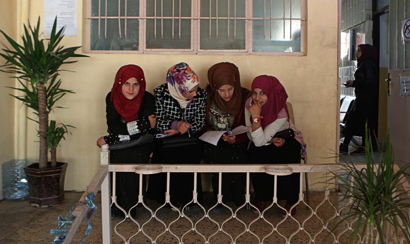 In this Feb. 26, 2019 photo, women wait for legal advice in a legal clinic supported by the Norwegian Refugee Council, in west Mosul, Iraq. (AP Photo/Khalid Mohammed)