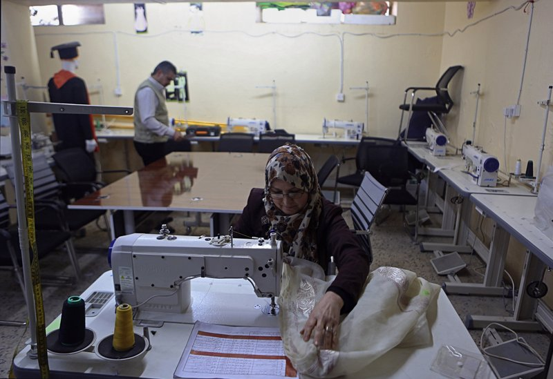 In this Feb. 26, 2019 photo, a widow of an Islamic State group militant trains at a sewing workshop supported by the Norwegian Refugee Council, in west Mosul, Iraq. (AP Photo/Khalid Mohammed)