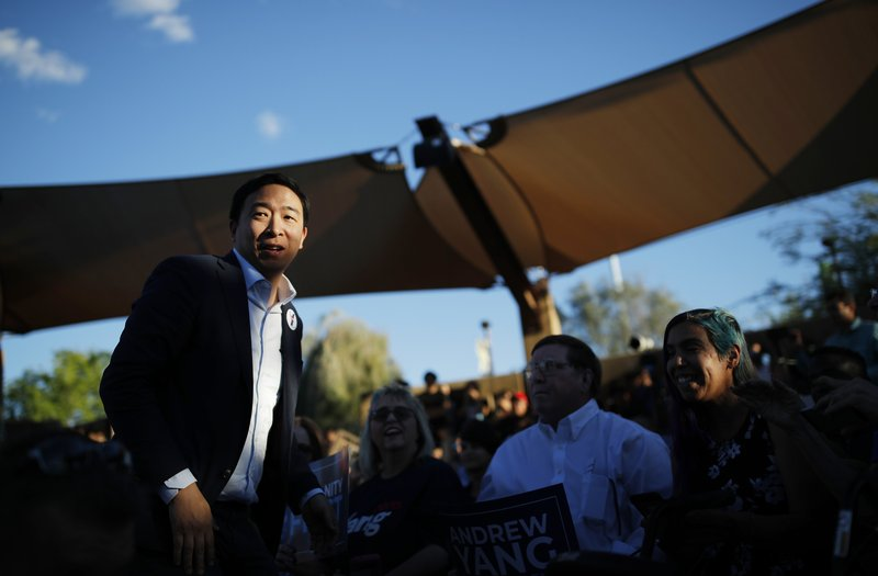 Democratic presidential candidate and entrepreneur Andrew Yang meets with supporters at a campaign event Tuesday, April 23, 2019, in Las Vegas. (AP Photo/John Locher)