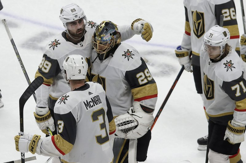 Vegas Golden Knights goaltender Marc-Andre Fleury (29) reacts with right wing Alex Tuch (89), defenseman Brayden McNabb (3) and center William Karlsson (71) after losing to the San Jose Sharks during overtime of Game 7 of an NHL hockey first-round playoff series in San Jose, Calif. (AP Photo/Jeff Chiu)