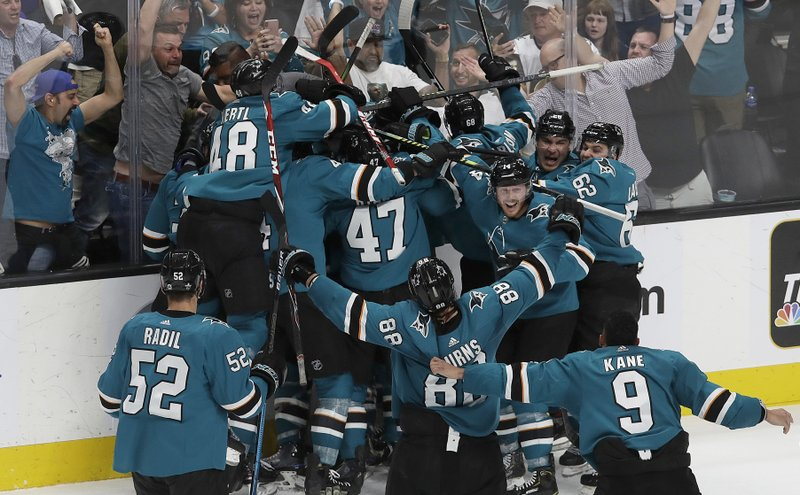 San Jose Sharks players celebrate after defeating the Vegas Golden Knights in Game 7 of an NHL hockey first-round playoff series in San Jose, Calif. (AP Photo/Jeff Chiu)