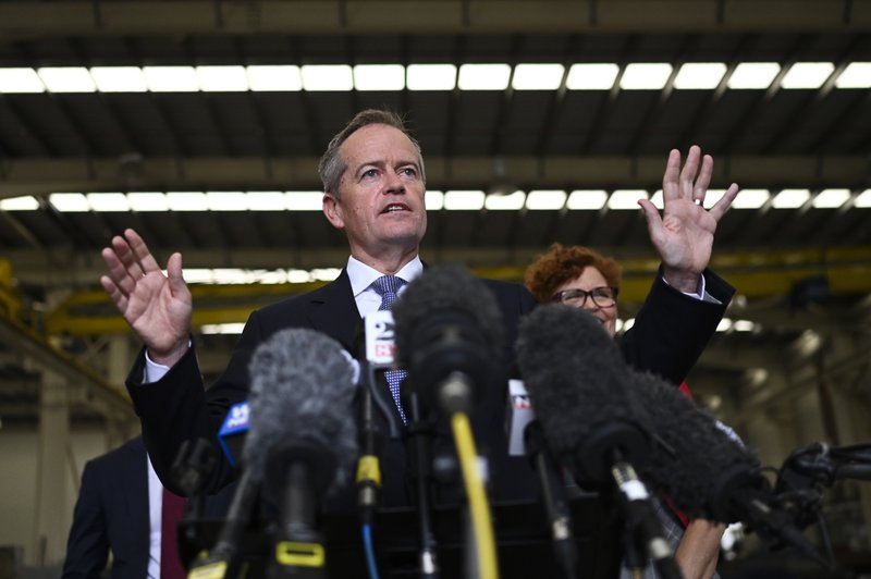 Australian opposition leader Bill Shorten speaks to the media during a press conference during a visit to a construction business in Townsville, Wednesday, April 24, 2019. (Lukas Coch/AAP Image via AP)
