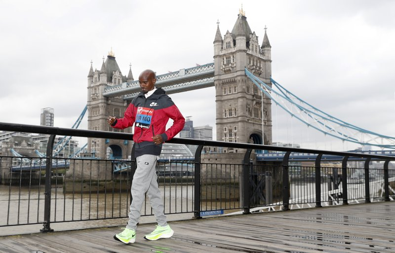 Britain's Mo Farah poses for the media during a photo call for the London Marathon in London, Wednesday, April 24, 2019. (AP Photo/Alastair Grant)