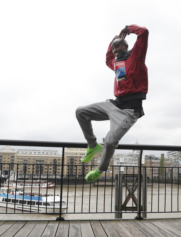 Britain's Mo Farah leaps as he poses for the media during a photo call for the London Marathon in London, Wednesday, April 24, 2019. (AP Photo/Alastair Grant)