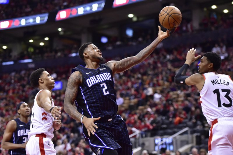 Orlando Magic forward Jarell Martin (2) shoots as Toronto Raptors guard Patrick McCaw (1) and Toronto Raptors forward Malcolm Miller (13) defend during the second half in Game 5 of a first-round NBA basketball playoff series, Tuesday, April 23, 2019 in Toronto. (Frank Gunn/Canadian Press via AP)