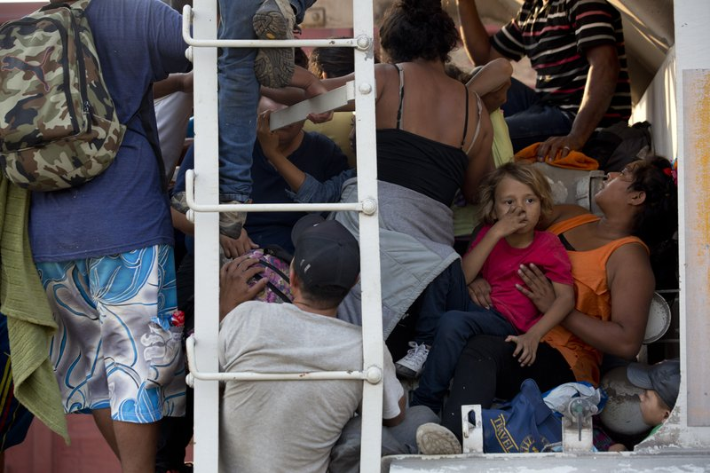 Central American migrants cram into a freight train during their journey toward the U.S.-Mexico border, in Ixtepec, Oaxaca State, Mexico, Tuesday, April 23, 2019. (Mexican) government doesn't want them to be seen. (AP Photo/Moises Castillo)