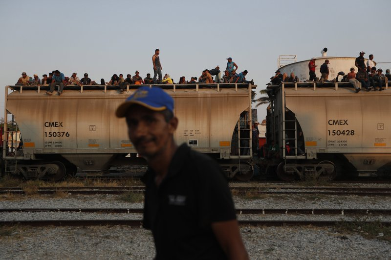 Central American migrants ride a freight train on their way to the U.S.-Mexico border, in Ixtepec, Oaxaca state, Mexico, Tuesday, April 23, 2019. (AP Photo/Moises Castillo)
