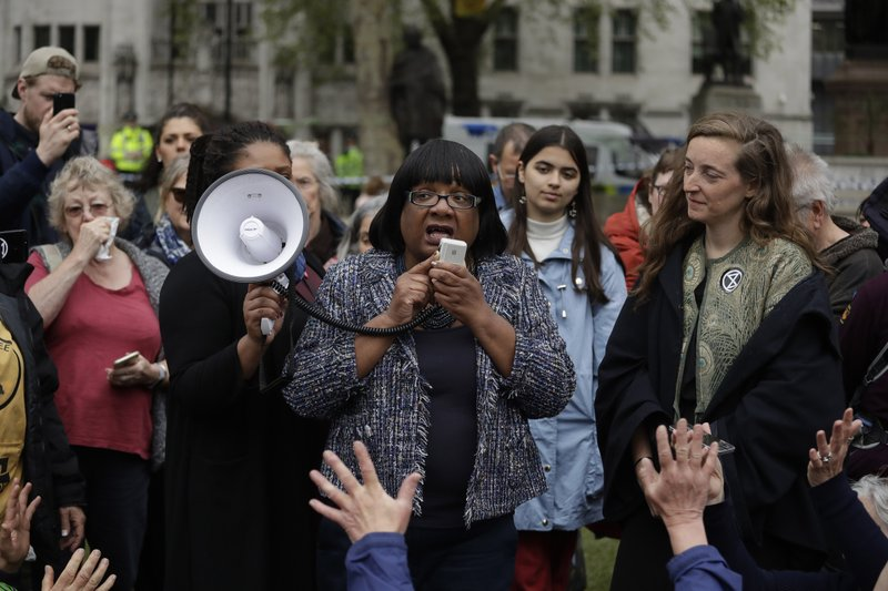Britain's opposition Labour Party Shadow Home Secretary Diane Abbott addresses Extinction Rebellion climate change protesters on Parliament Square in central London, Wednesday, April 24, 2019. (AP Photo/Matt Dunham)