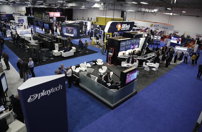This is a general view of exhibitors at the Betting On Sports America conference, Wednesday, April 24, 2019, in Secaucus, N. (AP Photo/Julio Cortez)