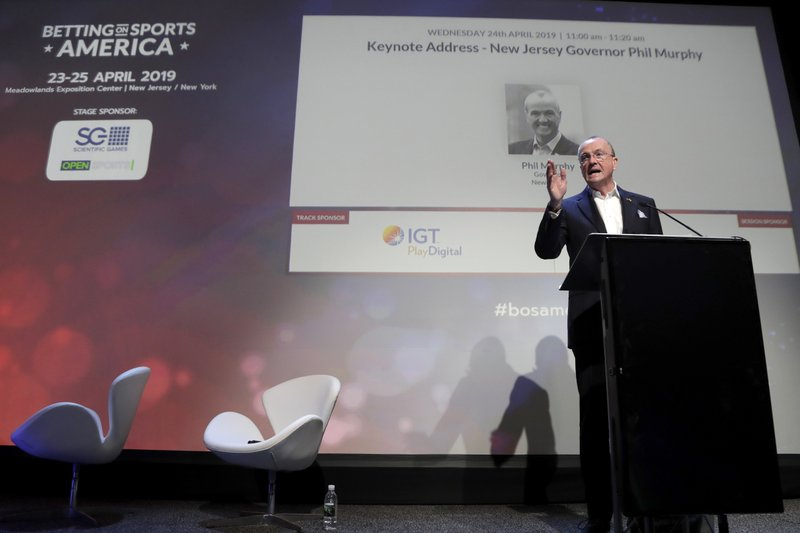 New Jersey Gov. Phil Murphy addresses an audience at the Betting On Sports America conference, Wednesday, April 24, 2019, in Secaucus, N. (AP Photo/Julio Cortez)