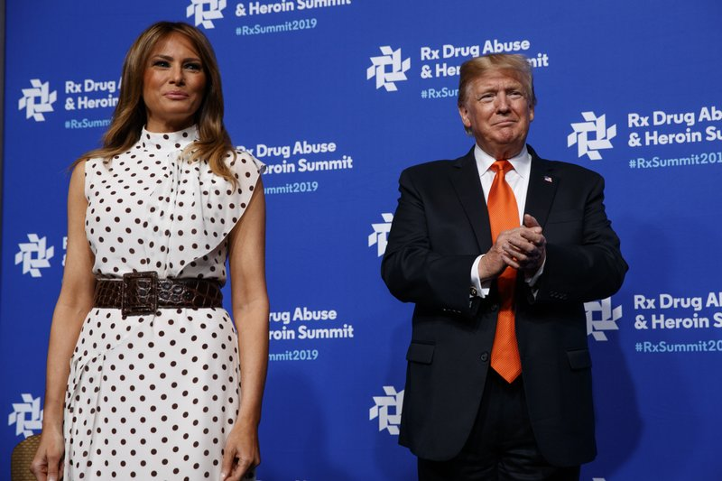 President Donald Trump and first lady Melania Trump arrive to speak at the