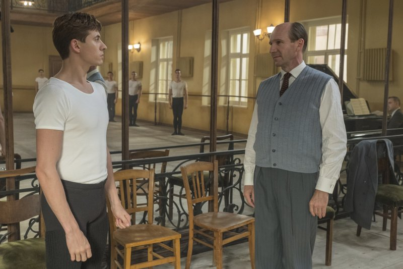 This image released by Sony Pictures Classics shows Oleg Ivenko as Rudolf Nureyev, left, and Ralph Fiennes as Alexander Pushkin in a scene from