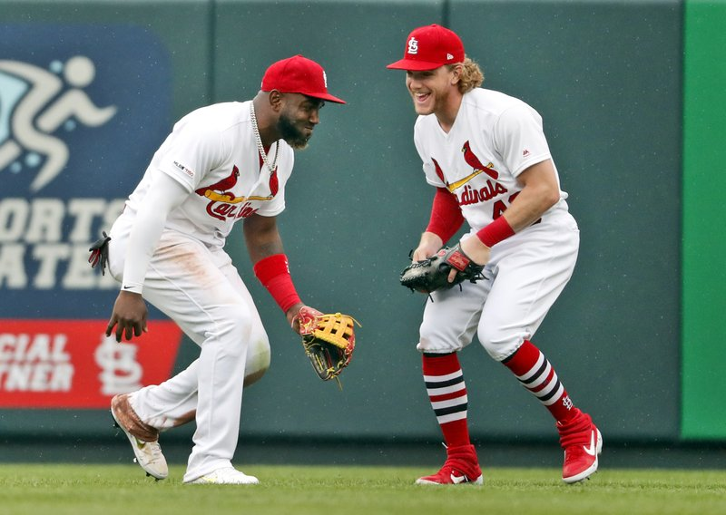 St. Louis Cardinals' Marcell Ozuna, left, and Harrison Bader celebrate following a baseball game against the Milwaukee Brewers Wednesday, April 24, 2019, in St. (AP Photo/Jeff Roberson)