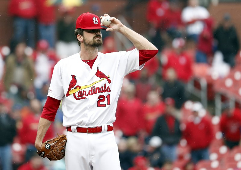 St. Louis Cardinals relief pitcher Andrew Miller adjusts his cap after walking in a run with the bases loaded during the ninth inning of a baseball game against the Milwaukee Brewers Wednesday, April 24, 2019, in St. (AP Photo/Jeff Roberson)