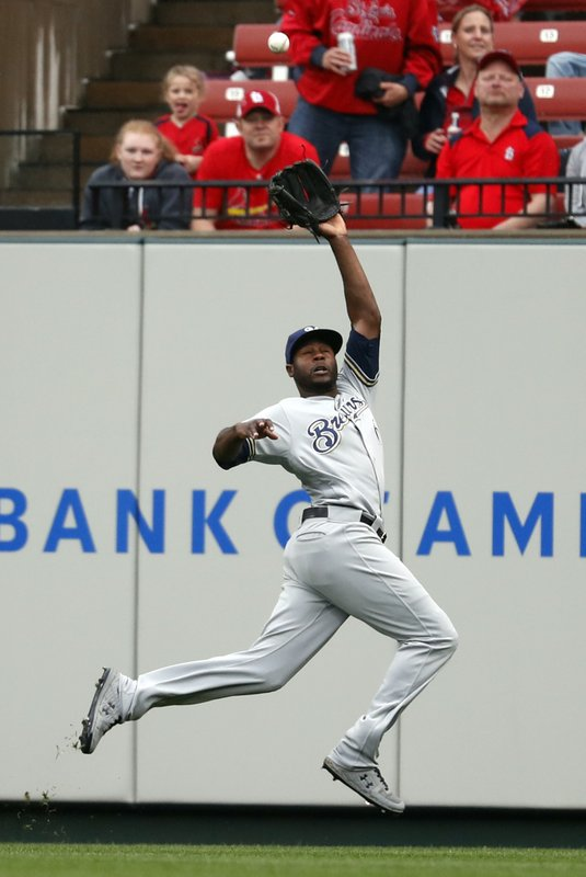 Milwaukee Brewers center fielder Lorenzo Cain leaps to catch a fly ball by St. Louis Cardinals' Yadier Molina during the sixth inning of a baseball game Wednesday, April 24, 2019, in St. (AP Photo/Jeff Roberson)