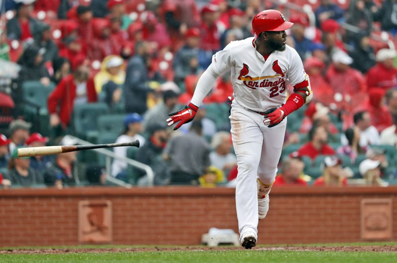 St. Louis Cardinals' Marcell Ozuna tosses his bat as he watches his three-run home run during the fourth inning of a baseball game against the Milwaukee Brewers Wednesday, April 24, 2019, in St. (AP Photo/Jeff Roberson)