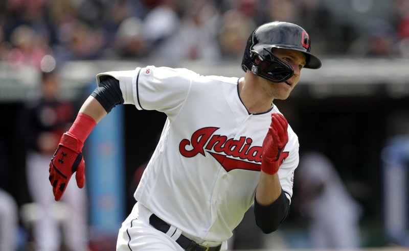 Cleveland Indians' Jake Bauers runs to first base after hitting an RBI-single off Miami Marlins relief pitcher Adam Conley in the eighth inning of a baseball game, Wednesday, April 24, 2019, in Cleveland. (AP Photo/Tony Dejak)