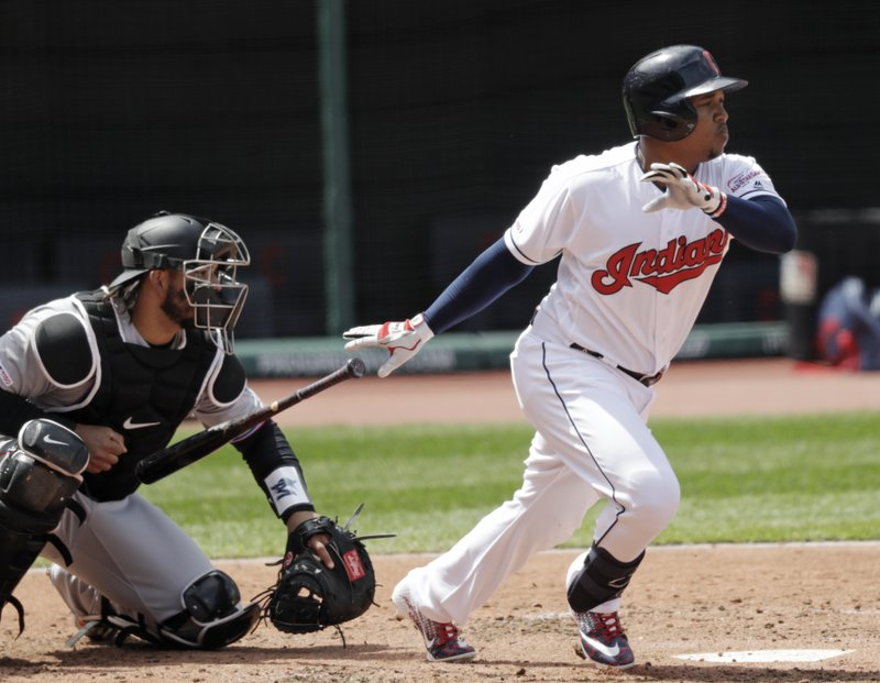 Cleveland Indians' Jose Ramirez watches his ball after hitting an RBI-single in the third inning of a baseball game, Wednesday, April 24, 2019, in Cleveland. (AP Photo/Tony Dejak)
