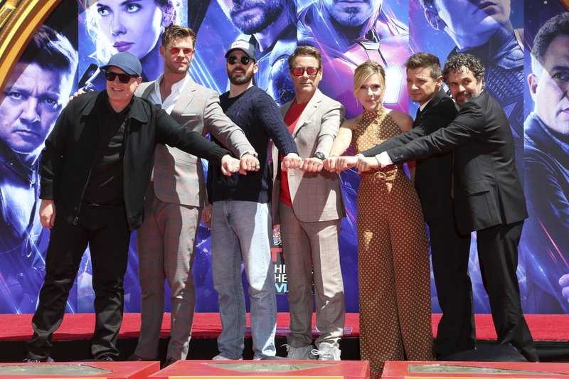 Marvel Studios President Kevin Feige, from left, poses with members of the cast of