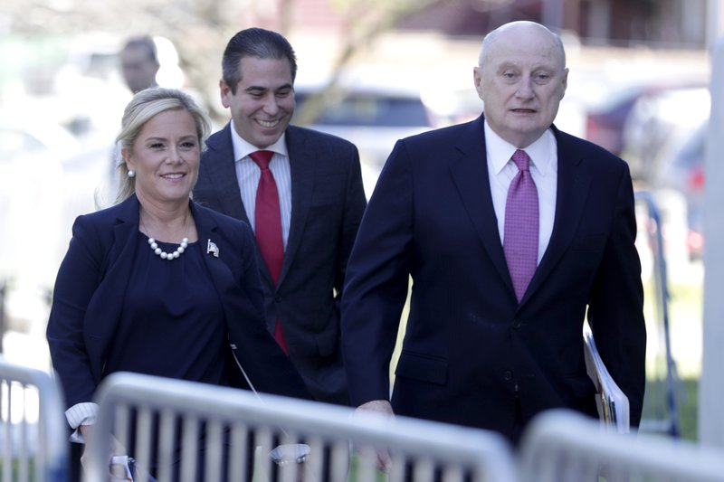 Bridget Anne Kelly, left, the former Deputy Chief of Staff for former New Jersey Gov. Chris Christie, walks with her lawyer Michael Critchley, right, and an associate while arriving at the Martin Luther King, Jr. (AP Photo/Julio Cortez)