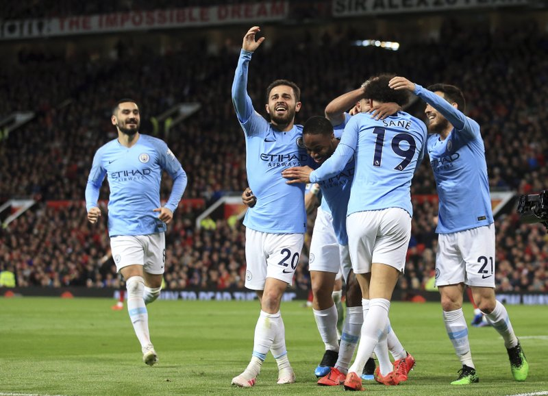 Manchester City's Leroy Sane, 2nd right, celebrates after scoring his side's second goal during the English Premier League soccer match between Manchester United and Manchester City at Old Trafford Stadium in Manchester, England, Wednesday April 24, 2019. (AP Photo/Jon Super)