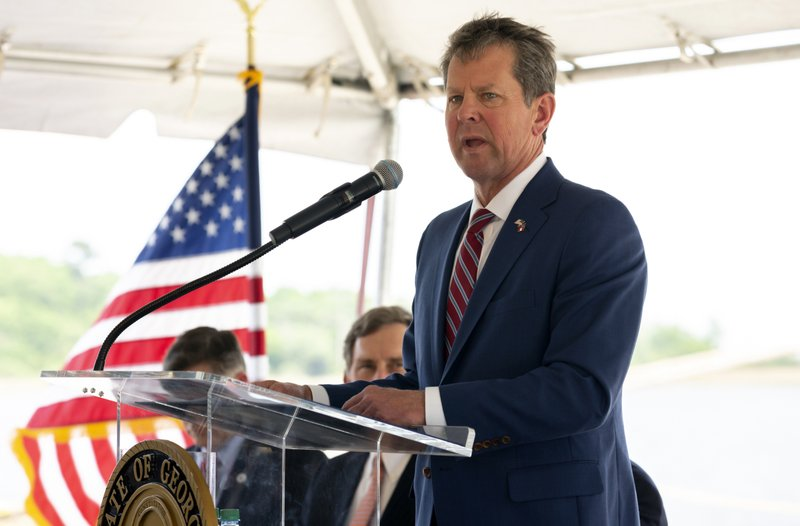 In this photo provided by the Georgia Port Authority, Georgia Governor Brian Kemp, right, joined the Georgia Department of Economic Development, the Savannah Economic Development Authority, Georgia Ports Authority and Plastic Express, Wednesday, April 24, 2019, to announce that Plastic Express will bring 166 high wage jobs and, along with Capital Development Partners, $172 million in investment to the region at an event at the Garden City Terminal at the Port of Savannah in Savannah, Ga. (Stephen Morton/Georgia Ports Authority via AP)
