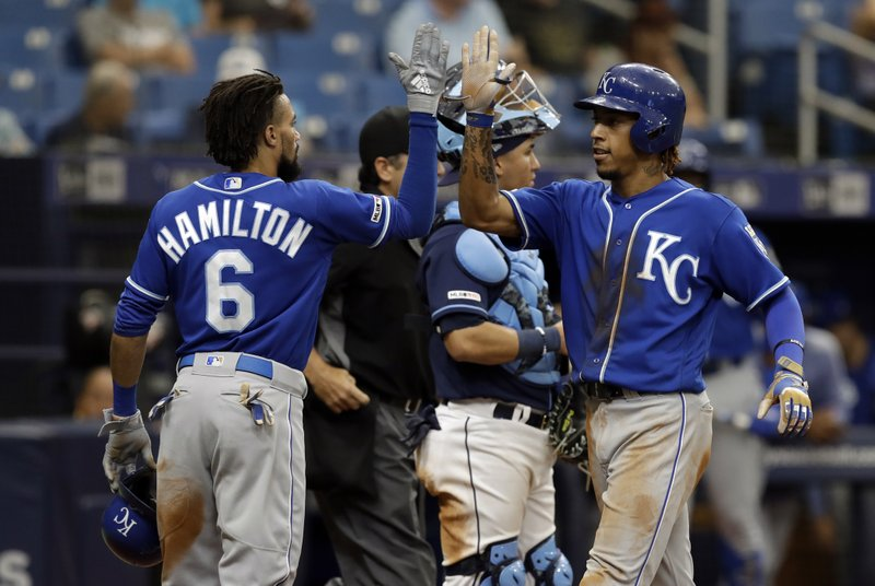 Kansas City Royals' Adalberto Mondesi, right, high fives Billy Hamilton after Mondesi hit a three-run home run off Tampa Bay Rays relief pitcher Ryan Yarbrough during the sixth inning of a baseball game Wednesday, April 24, 2019, in St. (AP Photo/Chris O'Meara)