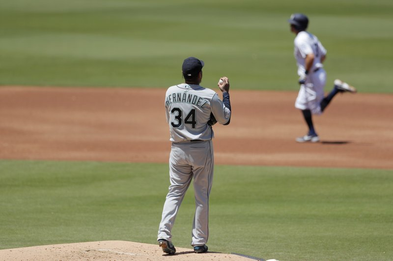 Seattle Mariners starting pitcher Felix Hernandez (34) looks on as the San Diego Padres' Ian Kinsler rounds the bases after hitting a home run during the second inning of a baseball game Wednesday, April 24, 2019, in San Diego. (AP Photo/Gregory Bull)