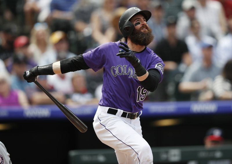 Colorado Rockies' Charlie Blackmon follows the flight of his solo home run against the Washington Nationals in the fourth inning of a baseball game Wednesday, April 24, 2019, in Denver. (AP Photo/David Zalubowski)