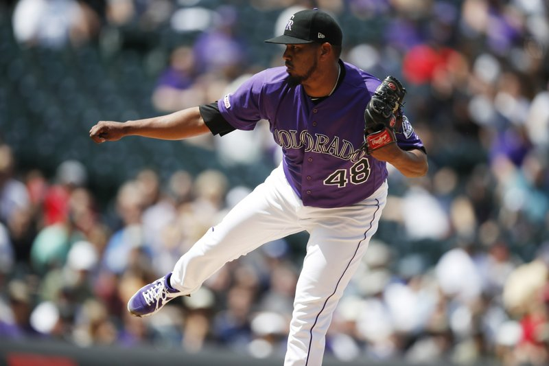 Colorado Rockies starting pitcher German Marquez works against the Washington Nationals in the first inning of a baseball game Wednesday, April 24, 2019, in Denver. (AP Photo/David Zalubowski)