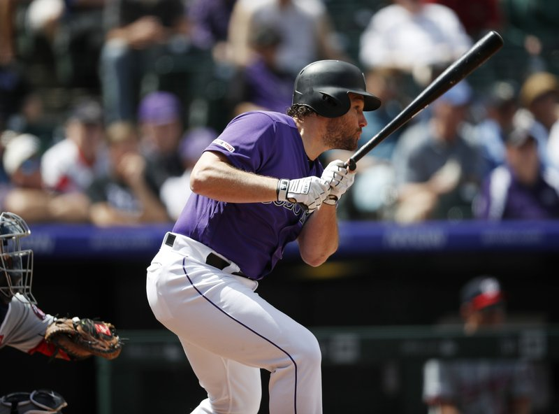 Colorado Rockies' Daniel Murphy singlesagainst the Washington Nationals in the first inning of a baseball game Wednesday, April 24, 2019, in Denver. (AP Photo/David Zalubowski)