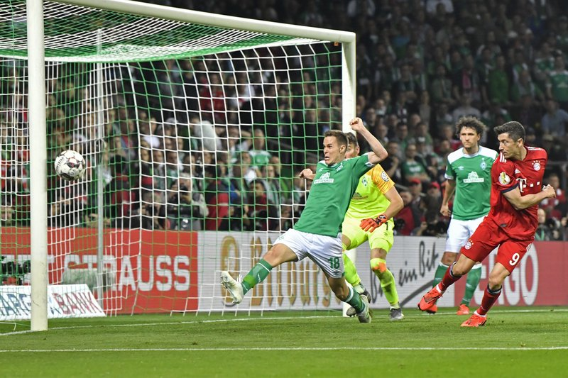 Bayern's Robert Lewandowski, right, sees his shot bounce off the post as Bremen's Niklas Moisander stretches in vain to block the shot during the German soccer cup, DFB Pokal, semifinal match between Werder Bremen and Bayern Munich at the Weser stadium in Bremen, Germany, Wednesday, April 24, 2019. (AP Photo/Martin Meissner)