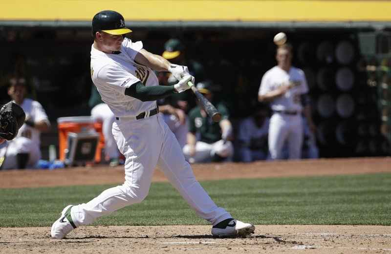 Oakland Athletics' Matt Chapman hits a solo home run against the Texas Rangers during the fifth inning of a baseball game in Oakland, Calif. (AP Photo/Jeff Chiu)