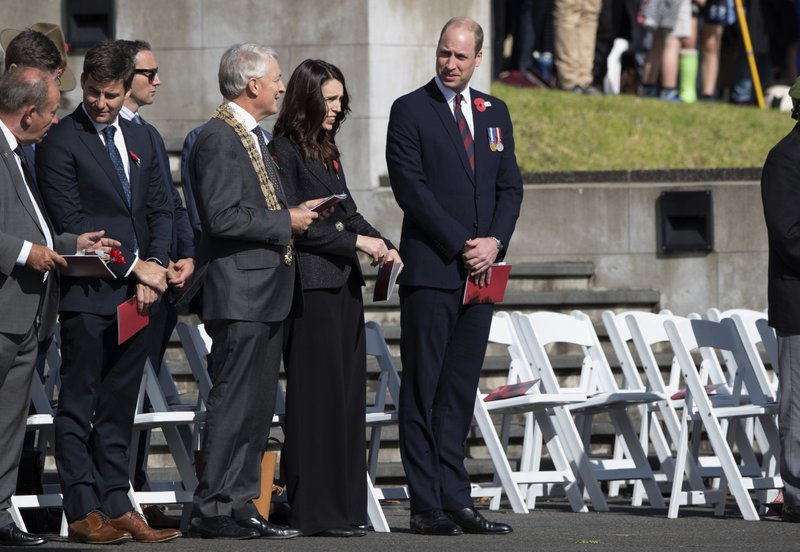 New Zealand Prime Minister Jacinda Ardern, center left, and Britain's Prince William arrive to lay a wreath during an Anzac Day service in Auckland, New Zealand, Thursday, April 25, 2019. (Brett Phibbs/SNPA via AP)