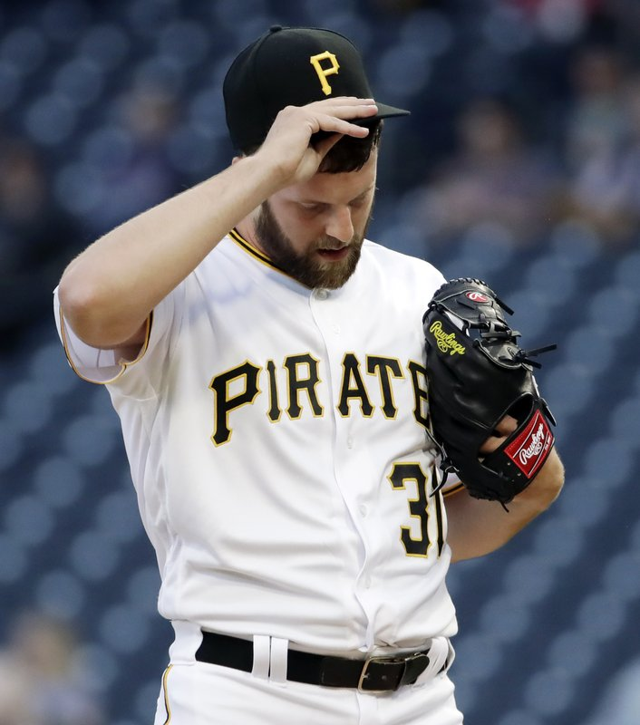 Pittsburgh Pirates starting pitcher Jordan Lyles collects himself on the mound after giving up a single to Arizona Diamondbacks' David Peralta, driving in a run, during the first inning of a baseball game in Pittsburgh, Wednesday, April 24, 2019. (AP Photo/Gene J. Puskar)