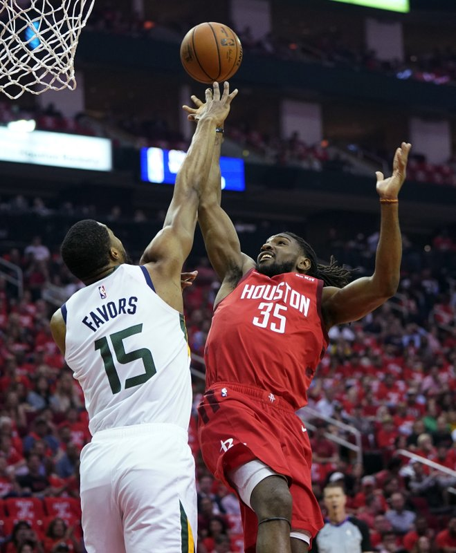 Houston Rockets forward Kenneth Faried (35) is blocked by Utah Jazz forward Derrick Favors (15) during the first half in Game 5 of an NBA basketball playoff series, in Houston, Wednesday, April 24, 2019. (AP Photo/David J. Phillip)