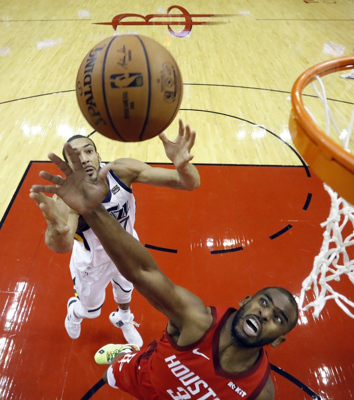 Utah Jazz center Rudy Gobert, left, and Houston Rockets guard Chris Paul (3) reach for a rebound during the first half of Game 5 of a first-round NBA basketball playoff series in Houston, Wednesday, April 24, 2019. (AP Photo/David J. Phillip)