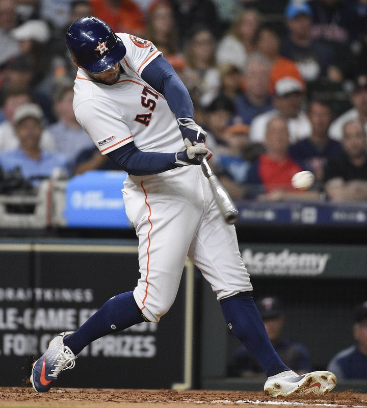 Houston Astros' George Springer hits a single during the third inning of a baseball game against the Minnesota Twins, Wednesday, April 24, 2019, in Houston. (AP Photo/Eric Christian Smith)