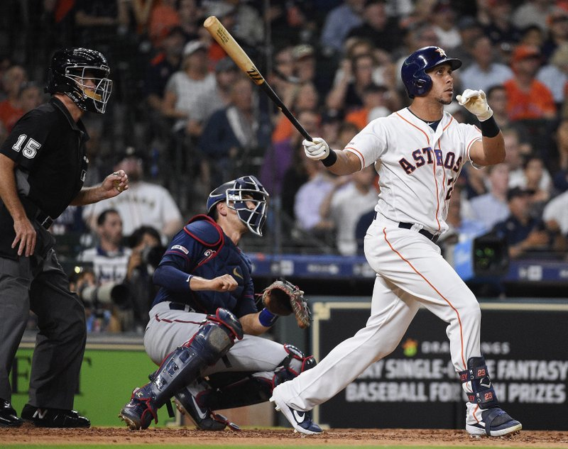 Houston Astros' Michael Brantley, right, hits. two-run home run off Minnesota Twins starting pitcher Kohl Stewart during the third inning of a baseball game, Wednesday, April 24, 2019, in Houston. (AP Photo/Eric Christian Smith)