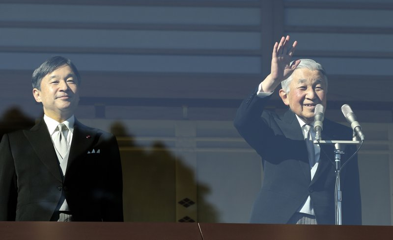 FILE - In this Dec. 23, 2017, file photo, Japan's Emperor Akihito, right,  waves to well-wishers, with Crown Prince Naruhito, left, on the bullet-proofed balcony of the Imperial Palace in Tokyo. (AP Photo/Koji Sasahara, File)