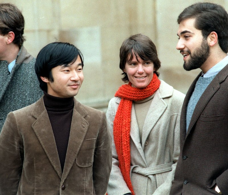 In this Dec. 1983, photo, then Prince Hiro, current Crown Prince Naruhito, left, chats with friend Keith George, right, at Merton College at Oxford in England. (Kyodo News via AP)