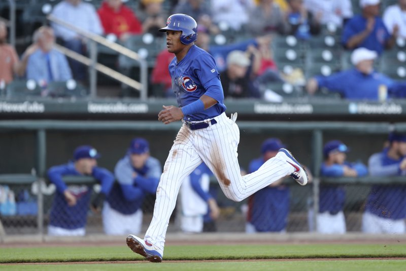 Iowa Cubs shortstop Addison Russell scores a run during a Triple-A baseball game against the Nashville Sounds, Wednesday, April 24, 2019, in Des Moines, Iowa. (AP Photo/Charlie Neibergall)