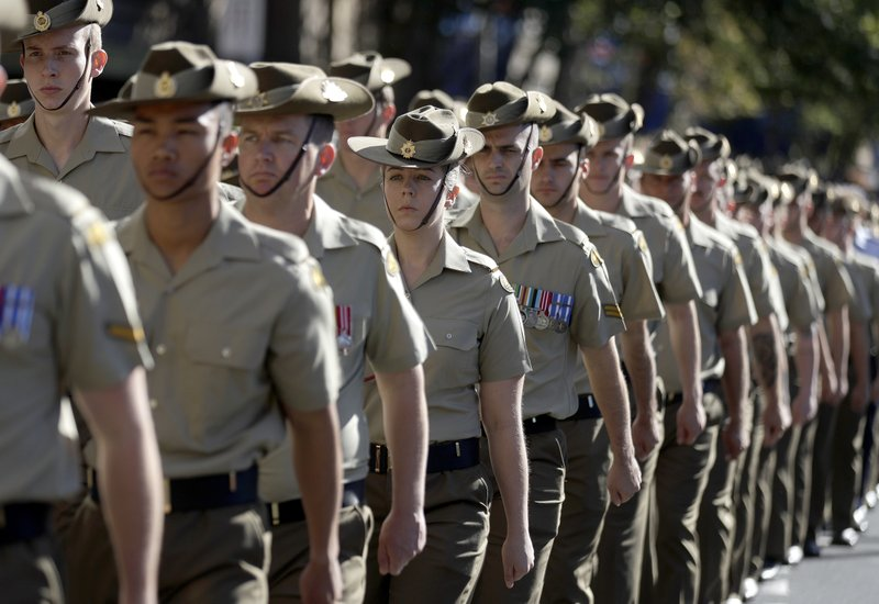 Members of the Australian Army march to celebrate ANZAC Day, a national day of remembrance in Australia and New Zealand that commemorates those that served and died in all wars, conflicts, and while peacekeeping, in Sydney, Australia, Thursday, April 25, 2019. (AP Photo/Rick Rycroft)
